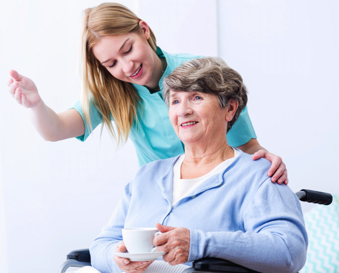 Picture of woman take care of elderly disabled patient